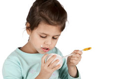 Girl eating yogurt Royalty Free Stock Photos