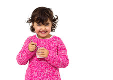 Girl eating yogurt Royalty Free Stock Image