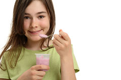 Girl eating yogurt Stock Photography