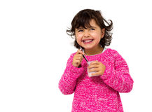 Girl eating yogurt Stock Images