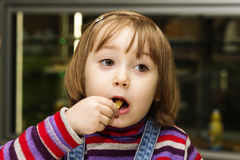 Girl is eats. Child eats in a cafe Stock Photography