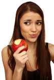 The girl eats a apple Stock Images
