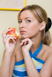 The girl eats an apple Royalty Free Stock Image