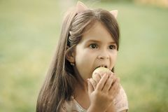 Girl eats an apple. Food, diet, vitamin Stock Photo