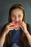 Girl eats bagel Royalty Free Stock Photo