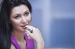 Girl eats Cake Stock Photo