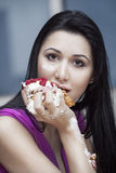 Girl eats Cake Royalty Free Stock Image