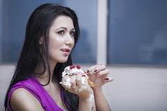 Girl eats Cake Stock Photography