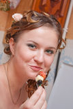 The girl eats a canape Stock Photography