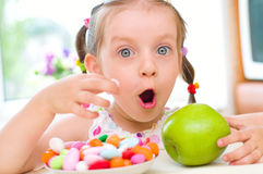 Girl eats candies Stock Images