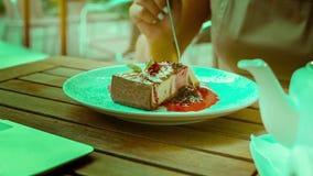 Girl eats cheesecake stock video footage