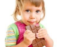 The girl eats chocolate Stock Photography