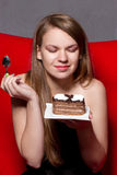 Girl eats chocolate cake Stock Photos