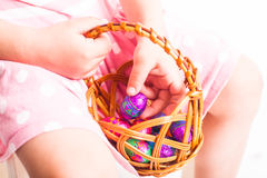 Girl eats a chocolate eggs Stock Photography