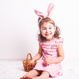 Girl eats a chocolate eggs Royalty Free Stock Photo