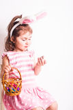 Girl eats a chocolate eggs Stock Images