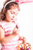 Girl eats a chocolate eggs Royalty Free Stock Photography