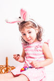 Girl eats a chocolate eggs Royalty Free Stock Images