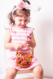 Girl eats a chocolate eggs Royalty Free Stock Image
