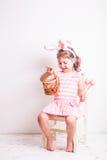 Girl eats a chocolate eggs Stock Photo