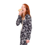 Girl eats a cookie Royalty Free Stock Photos