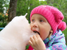 Girl eats cotton candy Stock Photo