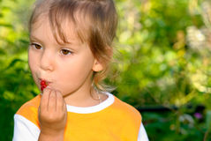 Girl eats currant Stock Photo