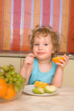 Girl eats fruit Royalty Free Stock Photo