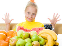 Girl eats fruit Royalty Free Stock Image
