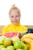 Girl eats fruit Stock Image