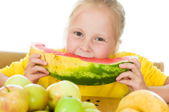 Girl eats fruit Stock Images
