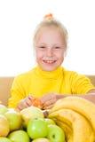 Girl eats fruit Royalty Free Stock Photo