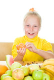Girl eats fruit Royalty Free Stock Images