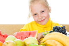 Girl eats fruit Royalty Free Stock Photography