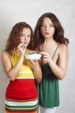 Girl eats fruit cake Royalty Free Stock Photo