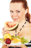Girl eats fruits Royalty Free Stock Photo