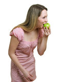 Girl eats a green apple Stock Image