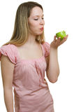 Girl eats a green apple Royalty Free Stock Image