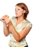 Girl eats a hamburger Royalty Free Stock Photo