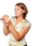 Girl eats a hamburger Royalty Free Stock Photo