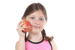 A Girl Eats Healthy. A little girl holding an apple and smiling Stock Images