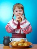 Girl eats homemade pie Stock Images