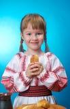 Girl eats homemade pie Stock Photos