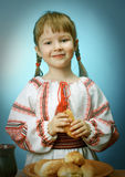 Girl eats homemade pie Royalty Free Stock Image