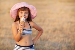 Girl eats ice cream Stock Images