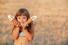 Girl eats ice cream Royalty Free Stock Photography