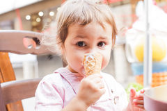 Girl eats an ice cream Stock Image