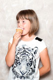 Girl eats ice cream Royalty Free Stock Images