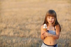 Girl eats ice cream Stock Images