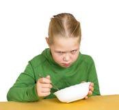 Girl eats isolated Royalty Free Stock Photo
